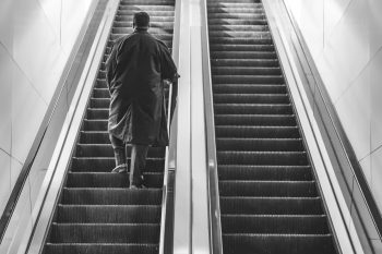 Man climbs escalator with presence and awareness